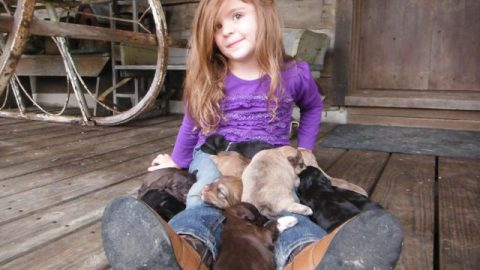 My Grand-daughter Paige Singing Puppies to Sleep!